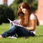 Beautiful woman reading magazine — Stock Photo