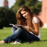 Beautiful woman reading magazine — Stock Photo #7803280