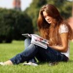 Beautiful woman reading magazine — Stock Photo #7803301