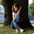 Beautiful girl sitting on grass - Foto Stock