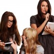 Three girls study documents — Stockfoto