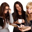 Three girls study documents — Stock Photo