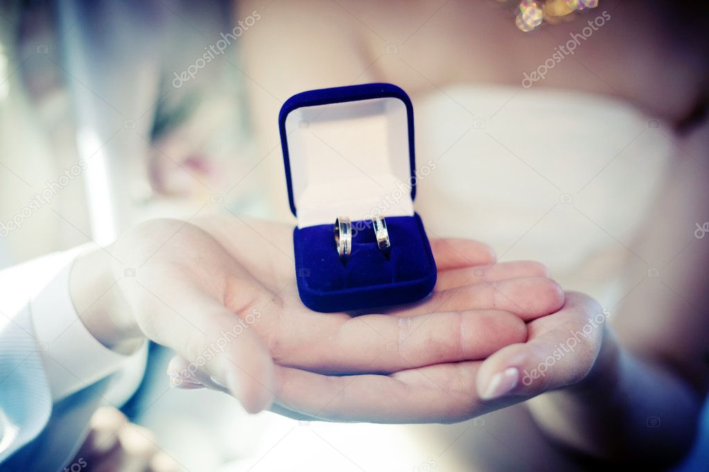 Hands of the groom and the bride with wedding rings in box — Stock Photo #6854655