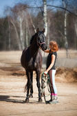 Young woman with horse — Foto de Stock