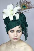 Girl in a green headdress — Stock Photo