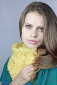 Girl in a yellow scarf — Stock Photo