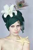 Girl in an exotic hat — Fotografia Stock
