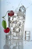 Splashing water in glass — Stock Photo