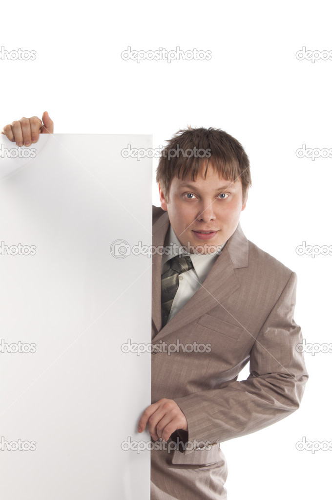 Smiling businessman holding a blank white board — Stock Photo #7631410