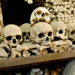 Skulls and bones in the bone chapel in Kutna Hora, Czech Republic - Foto Stock