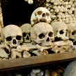 Skulls and bones in the bone chapel in Kutna Hora, Czech Republic - Stok fotoğraf