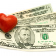Red Heart on dollar — Stock Photo