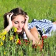 Teen girl laying on the meadow — Stock Photo
