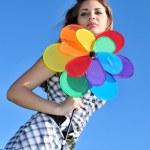 Girl holding windmill — Stock Photo #6754327