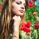 Pensive girl in poppy field — Stock Photo #6754348