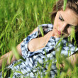Lady in grass — Stock fotografie