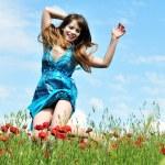 Jump in poppy field — Stock Photo