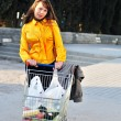 Girl with shopping trolley — Stock Photo #6754439
