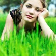 Elegant girl on the meadow - Stock Photo