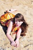 Girl laying on the sand — Stock Photo