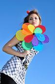 Girl holding windmill — Stock Photo