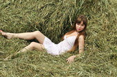 Woman relaxing on the hayloft — Stock Photo