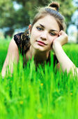 Elegant girl on the meadow — Stock Photo