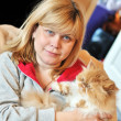Woman with her cat - Stockfoto