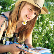Teen girl reading a book — Stock Photo