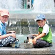 Boys near waterworks; — Stock Photo