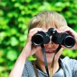 Boy looking through binocular — Stock Photo #7260302