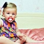 Baby girl using comb — Stock Photo #7260307