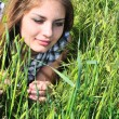Sweet tender girl in grass - Stock Photo