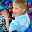 Boy playing with balls — Stock Photo #7260373