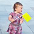 Baby girl holding flag — Stock Photo