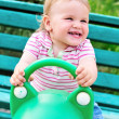 Stock Photo: Swinging baby