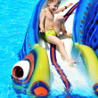 Fun on water slide - Stock Photo