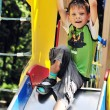 Funny boy on the slide — Stock Photo