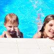 Brothe and sister in the pool — Stock Photo