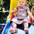 Baby on slide — Stock Photo
