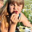 Girl liking strawberry — Stock Photo #7261361