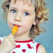 Girl with lollipop — Stock Photo #7261726