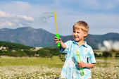 Boy and soap bubbles — Stock Photo