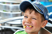 Little boy enjoying french fries — Stock Photo