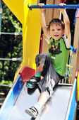 Funny boy on the slide — Foto Stock