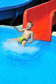 Child on water slide — Stock Photo