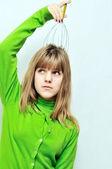Girl using scalp massager — Stock Photo