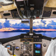 Stock Photo: Pilots in the plane cockpit and island