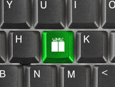 Computer keyboard with gift key — Stock Photo