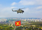 Helicopter with military flag over Moscow at parade of victory d — Stock Photo
